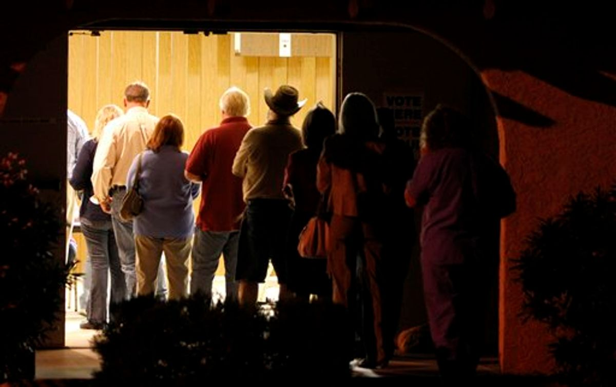 Voters line up to vote before sunrise on election day Tuesday, Nov. 2, 2010, in Apache Junction, Ariz. (AP Photo/Ross D. Franklin) (AP)