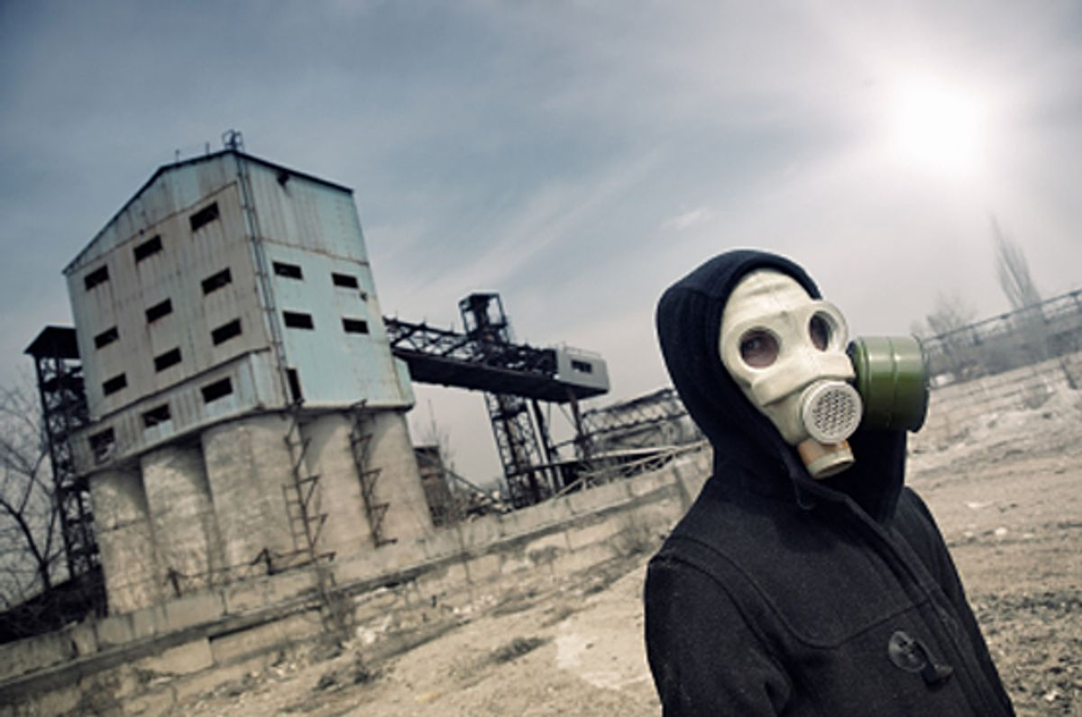 Human in gas mask outdoors and industrial factory on a background (Arman Zhenikeyev)