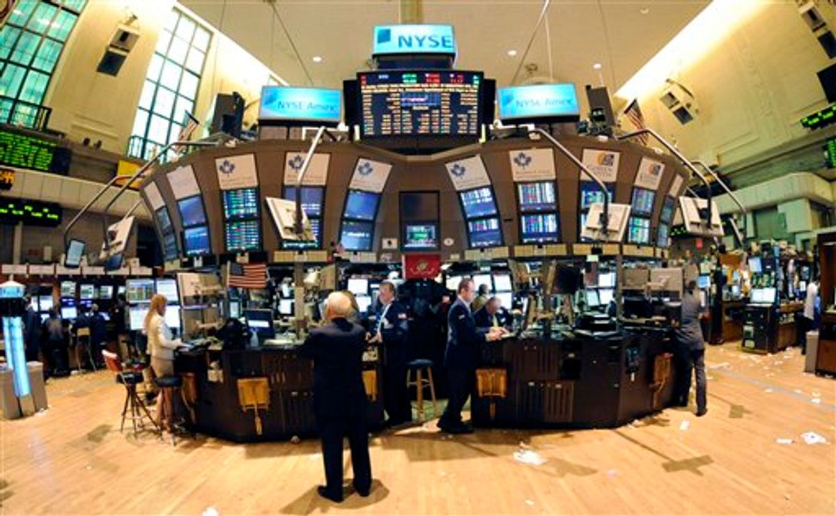 In this photo taken Sept. 21, 2010, trading continues on the floor of the New York Stock Exchange in New York. Stock futures edged lower Wednesday, Sept. 22, as traders turned to buying Treasury's and gold after the Federal Reserve failed to take any immediate steps to help the economy.(AP Photo/Henny Ray Abrams) (AP)