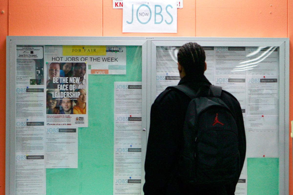 A man looks over employment opportunities at a jobs center in San Francisco.