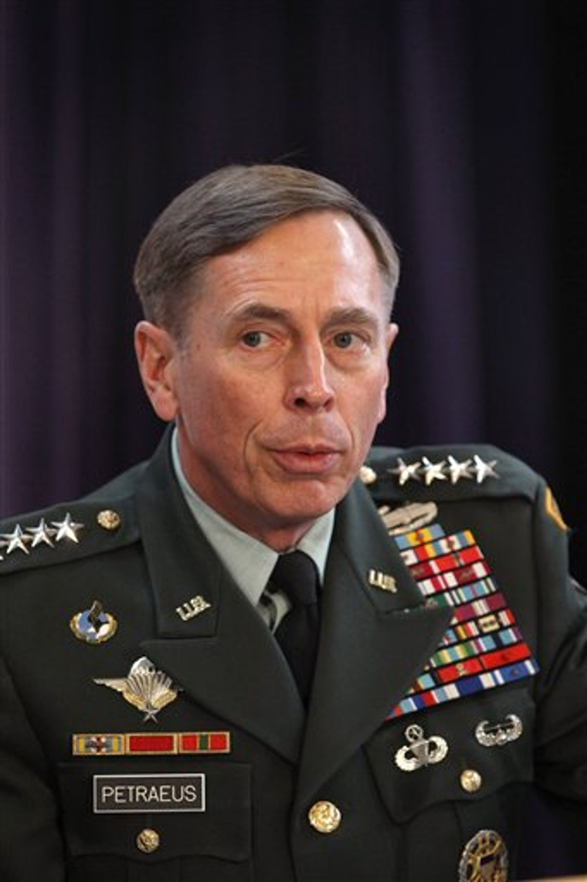 Gen. David Petraeus, the top U.S and NATO commander addresses RUSI members on 'The International Mission in Afghanistan', at the United Services Institute in central London, Friday Oct. 15, 2010.  Petraeus has confirmed that NATO has provided safe passage for top Taliban leaders to travel to Kabul for face-to-face negotiations with the American-backed Afghan government.    (AP Photo/Dan Kitwood, Pool) (AP)