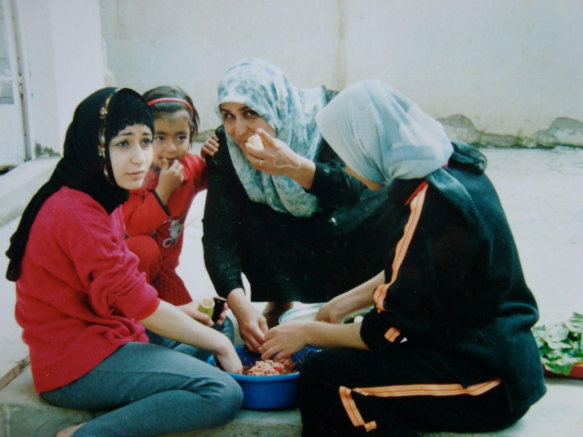 Afghan women prepare a meal.
