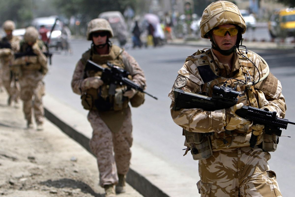 British soldiers patrol on a street in Kabul in July