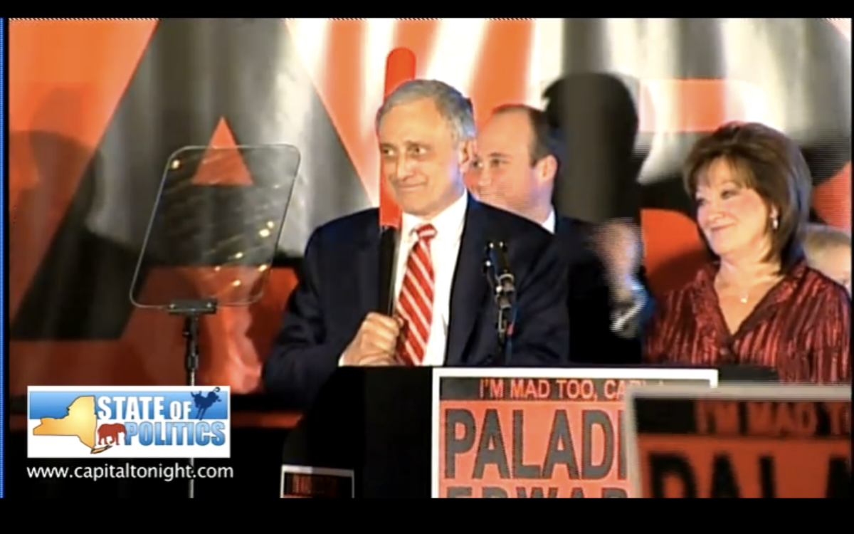 Carl Paladino holding a baseball bat during his concession speech Tuesday night.