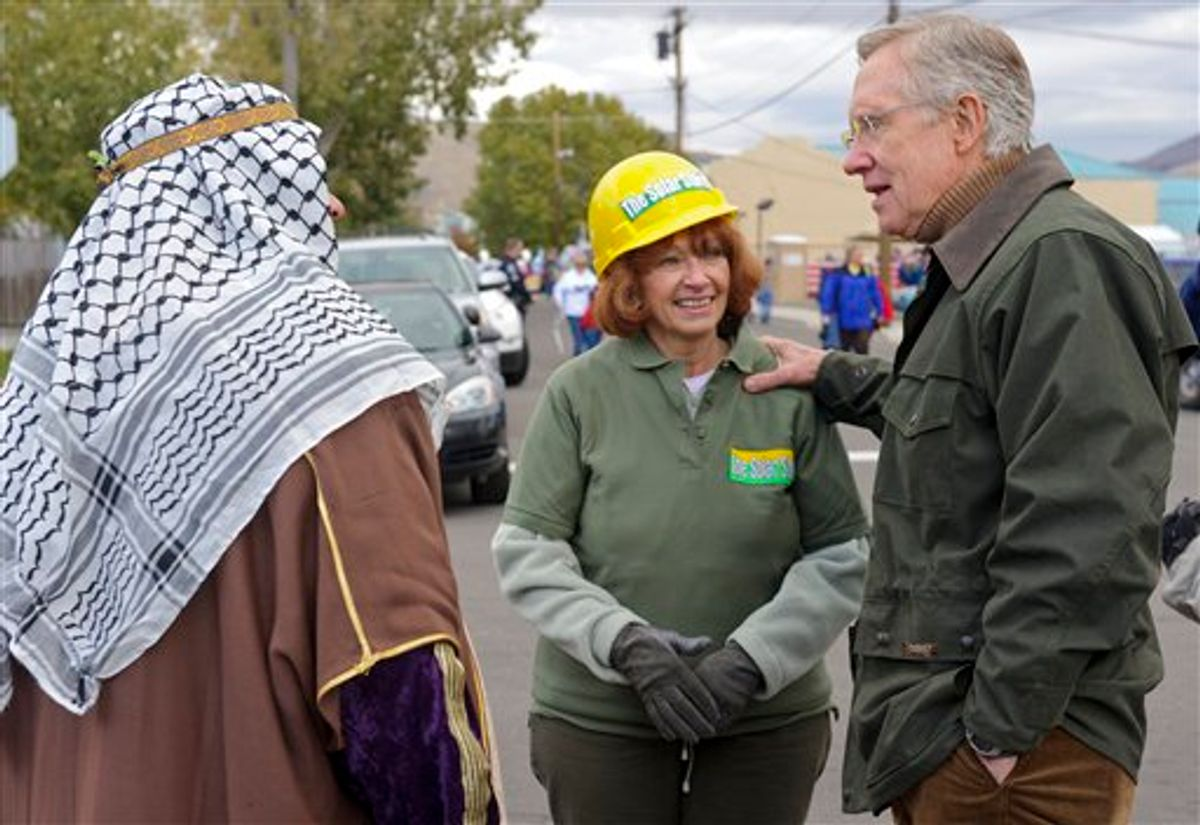 Nevada Sen. Harry Reid, D-Nev., talks with Leslie and James Medeiros, who are in costume to protest our dependence on foreign oil, during the Nevada Day Parade in Carson City, Nev., Saturday, Oct. 30, 2010. (AP Photo/Scott Sady) (AP)