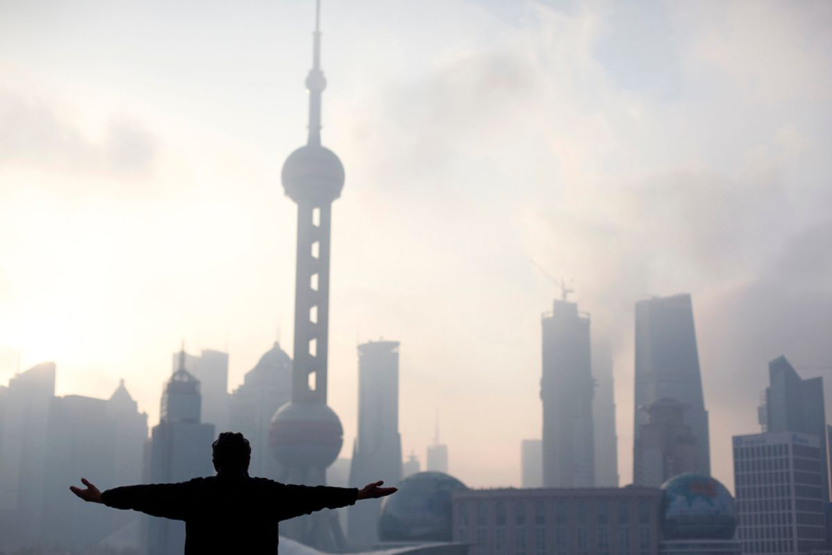 A man practices Tai Chi during an early morning session at the Bund, on the banks of the Huangpu River, following its reopening after a massive renovation for the upcoming Shanghai World Expo 2010 in Shanghai March 29, 2010. Shanghai underwent a massive facelift for the coming Shanghai World Expo due to start on May 1, 2010. The Oriental Pearl tower is seen in the background. REUTERS/Nir Elias (CHINA - Tags: BUSINESS SOCIETY IMAGES OF THE DAY) (© Nir Elias / Reuters)