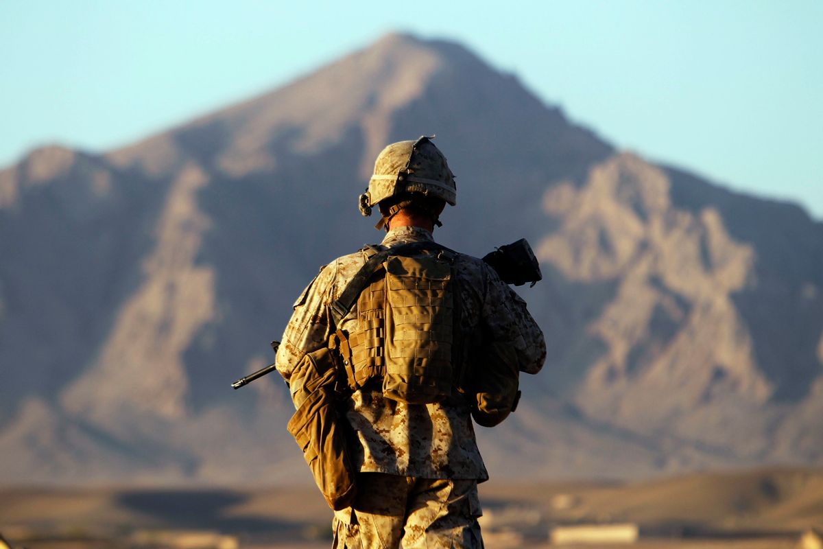 A U.S. Marine from the First Battalion Eighth Marines Alpha Company patrols in the town of Nabuk in southern Afghanistan's Helmand province, October 31, 2010. REUTERS/Finbarr O'Reilly (AFGHANISTAN - Tags: CONFLICT CIVIL UNREST MILITARY) (Reuters)