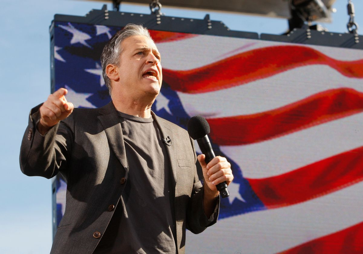"""Comedian Jon Stewart addresses the crowd during the """"Rally to Restore Sanity and/or Fear"""" in Washington, October 30, 2010. The rally is a counterpoint to recent partisan political rallies on both ends of the U.S. political spectrum  held in anticipation of the November 2nd Congressional midterm elections.   REUTERS/Jim Bourg  (UNITED STATES - Tags: POLITICS ENTERTAINMENT) (Reuters)"""