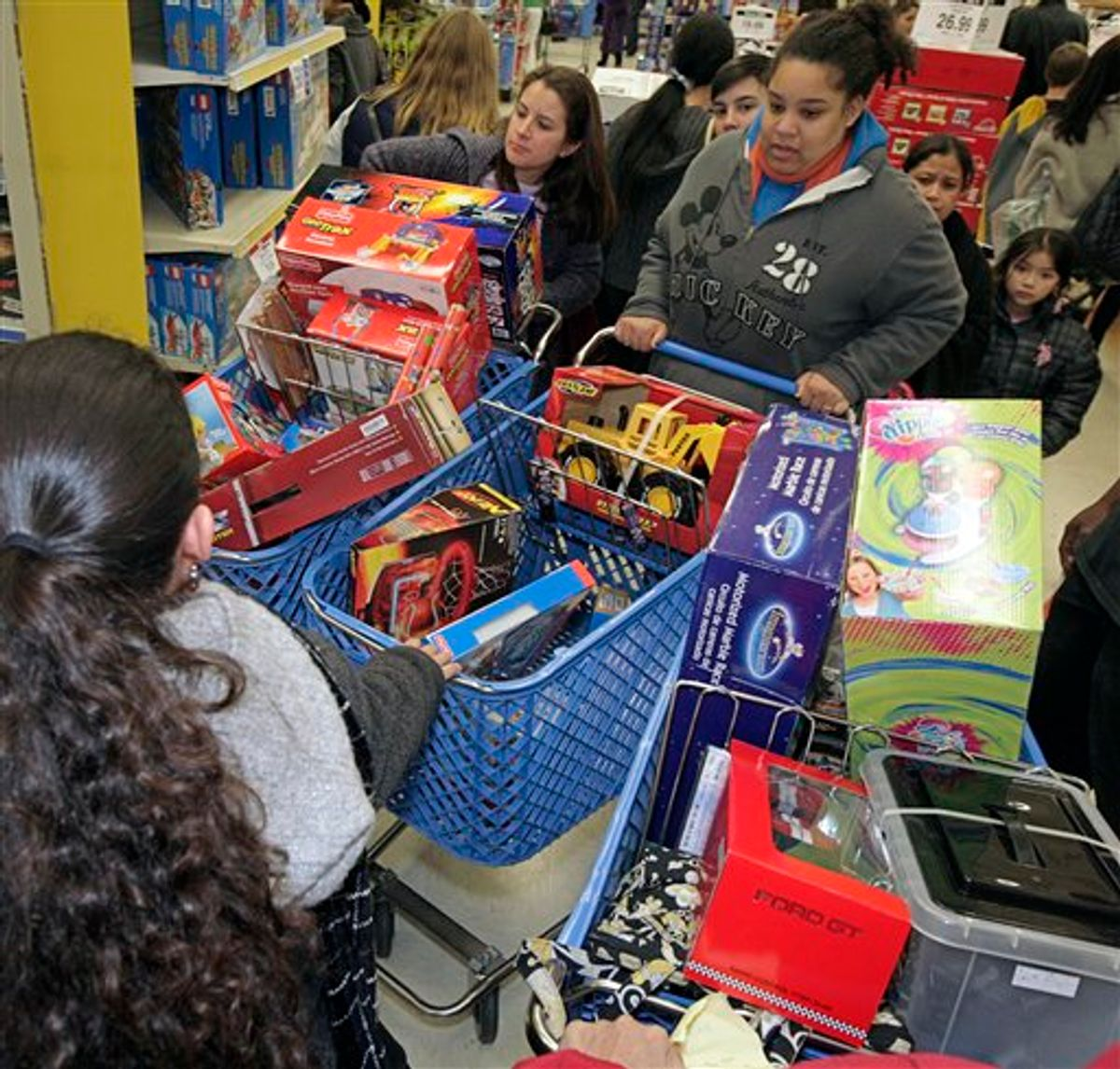 A traffic jam is negotiated in the aisles of Toys R Us, in San Rafael Calif., Thursday Nov. 25, 2010 which was crowed with Black Friday shoppers. (AP Photo/Mike Adaskaveg)   (AP)