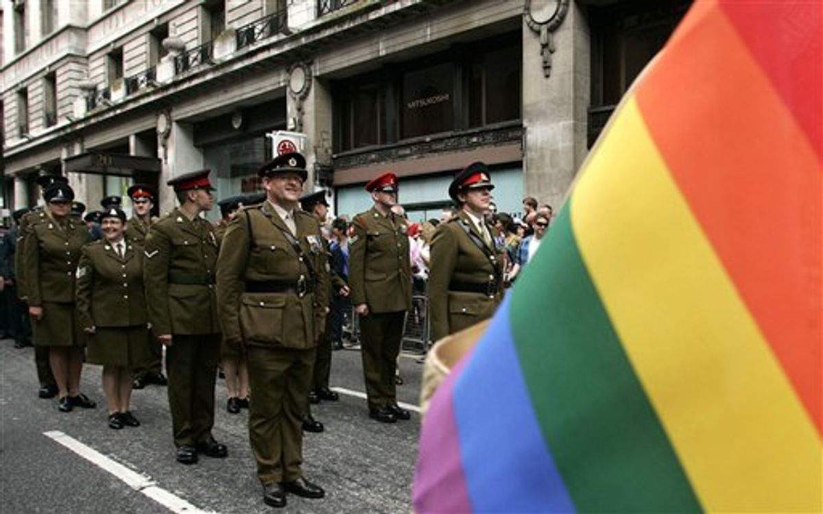 FILE - In this July 4, 2009 file photo, military personnel join the march during an annual gay pride parade in central London organized by Pride London, the lesbian, gay, bisexual, and transgender charity. Most of America's closest allies opted years ago to allow gays to serve openly in their militaries. As U.S. policymakers wrestle with the issue, there's sharp disagreement over whether those allies' experiences are relevant to the debate. (AP Photo/Akira Suemori, File) (AP)