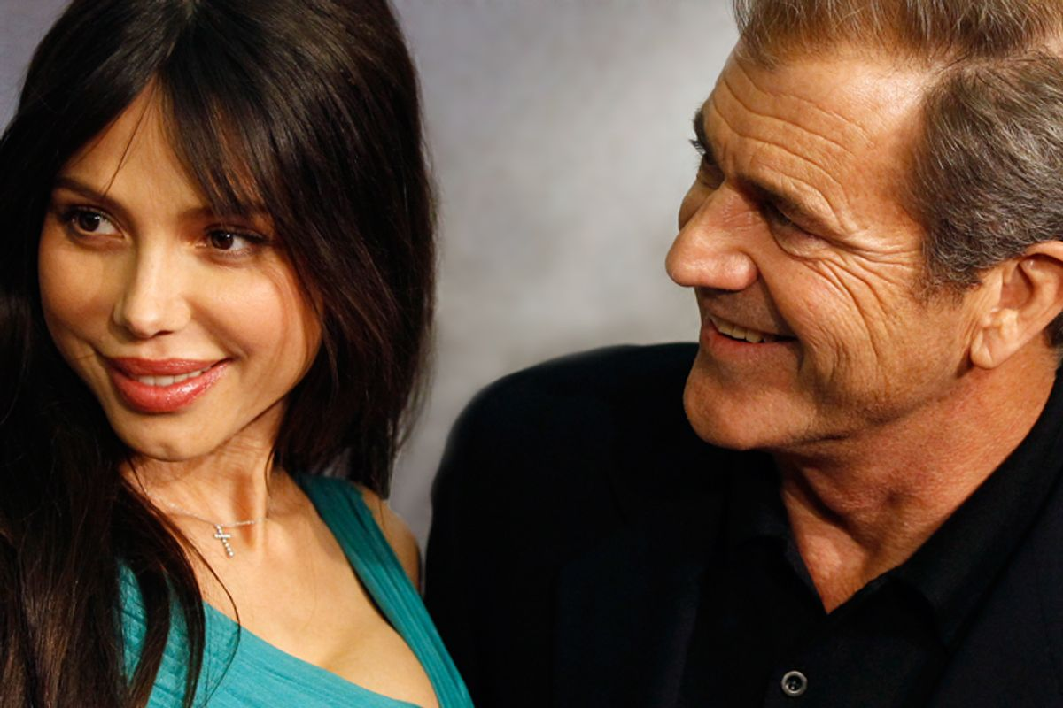 """Actor Mel Gibson (R) and Oksana Grigorieva pose during the Spanish premiere of the film """"Edge of Darkness"""" on February 1, 2010."""
