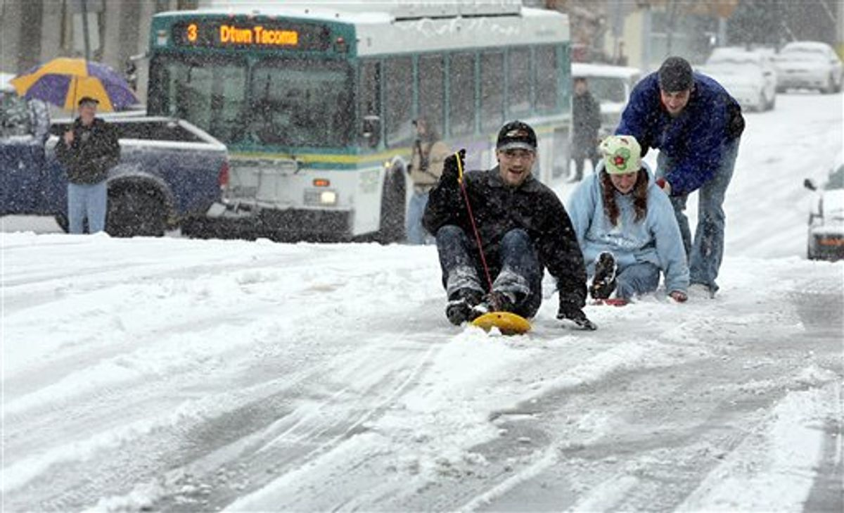 From left, William Gordon, Jessica Fuller and Howie West, make use of alternate forms of transportation after South Ninth Street became unsafe for many vehicles in downtown Tacoma, Wash., Monday, Nov. 22, 2010.  A few minutes earlier the Pierce Transit bus, background, slid into a pickup truck. People in most of Eastern Washington were told Monday to prepare for a rare blizzard as the first severe storm of the winter blasted through the state, though weather officials said it was too early to tell if the rough weather would affect Thanksgiving holiday travel later in the week. (AP Photo/The News Tribune, Janet Jensen) (AP)
