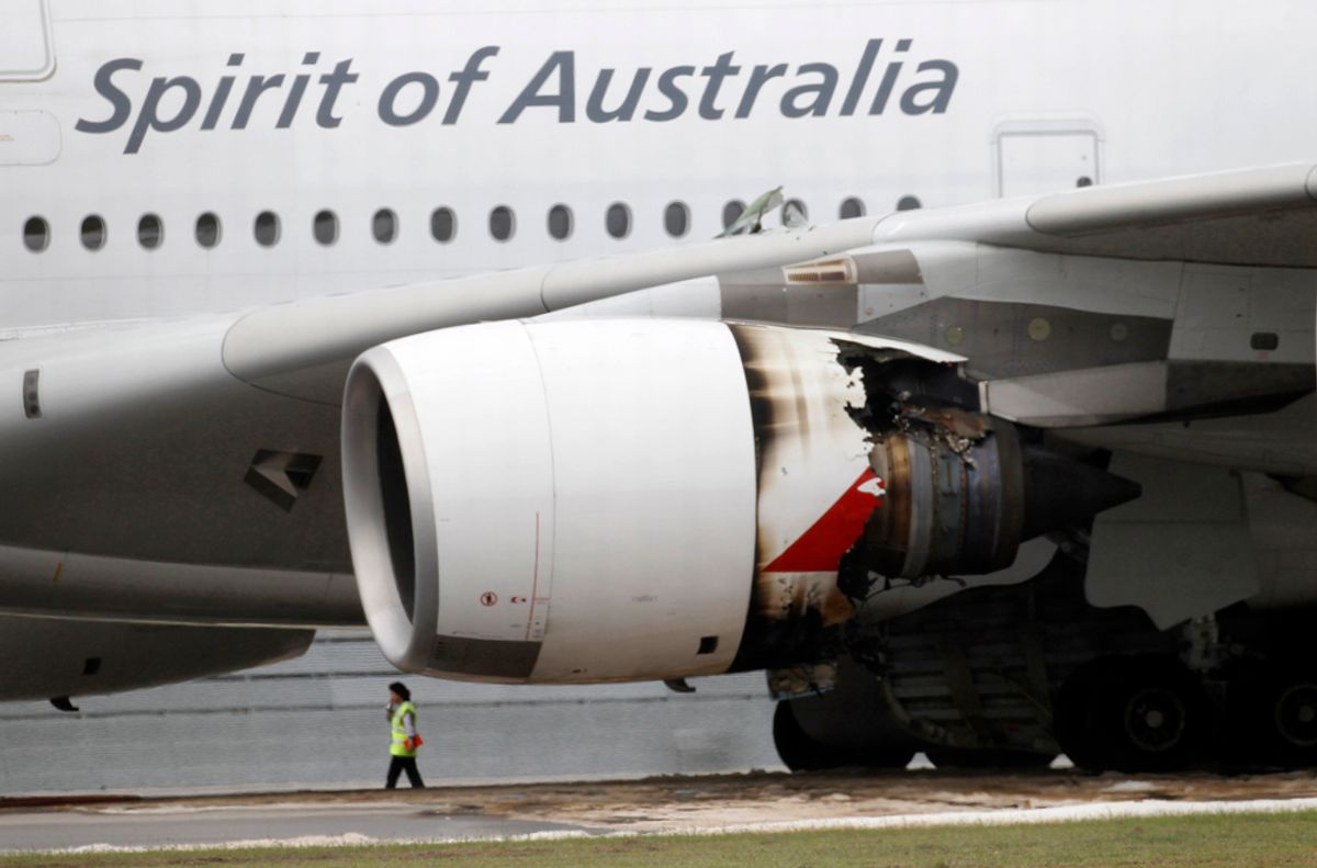 Qantas Airways A-380 passenger plane QF32 with its partially damaged engine sits on the tarmac after making an emergency landing at Changi airport in Singapore November 4, 2010. The Qantas Airways passenger plane carrying 459 people was forced to shut down an engine and return to to Singapore's Changi airport on Thursday, ending speculation that it had crashed, the airline and Singapore state TV said.   REUTERS/Vivek Prakash   (SINGAPORE - Tags: TRANSPORT DISASTER BUSINESS) (© Vivek Prakash / Reuters)