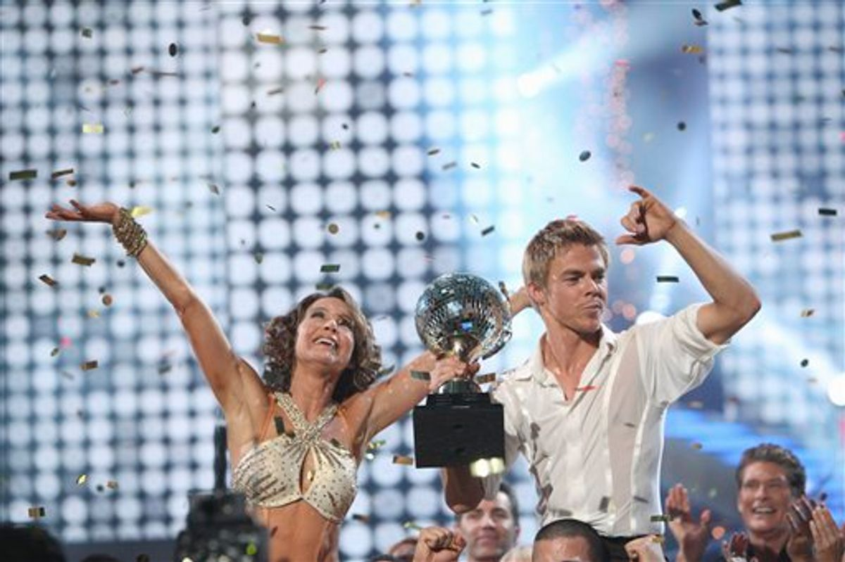 In a photo provided by ABC, Jennifer Grey, left, and Derek Hough celebrate on stage with the mirror ball trophy after winning the Dancing with the stars competition Tuesday Nov. 23, 2010 in Los Angeles.   (AP PHOTO/ABC/ADAM LARKEY)  (AP)