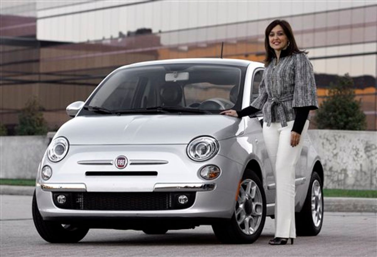 In this Nov. 10, 2010 photo, Laura J. Soave, head of the Fiat Brand for North America, stands next to a 2011 Fiat 500 in Auburn Hills, Mich.  (AP Photo/Paul Sancya) (AP)
