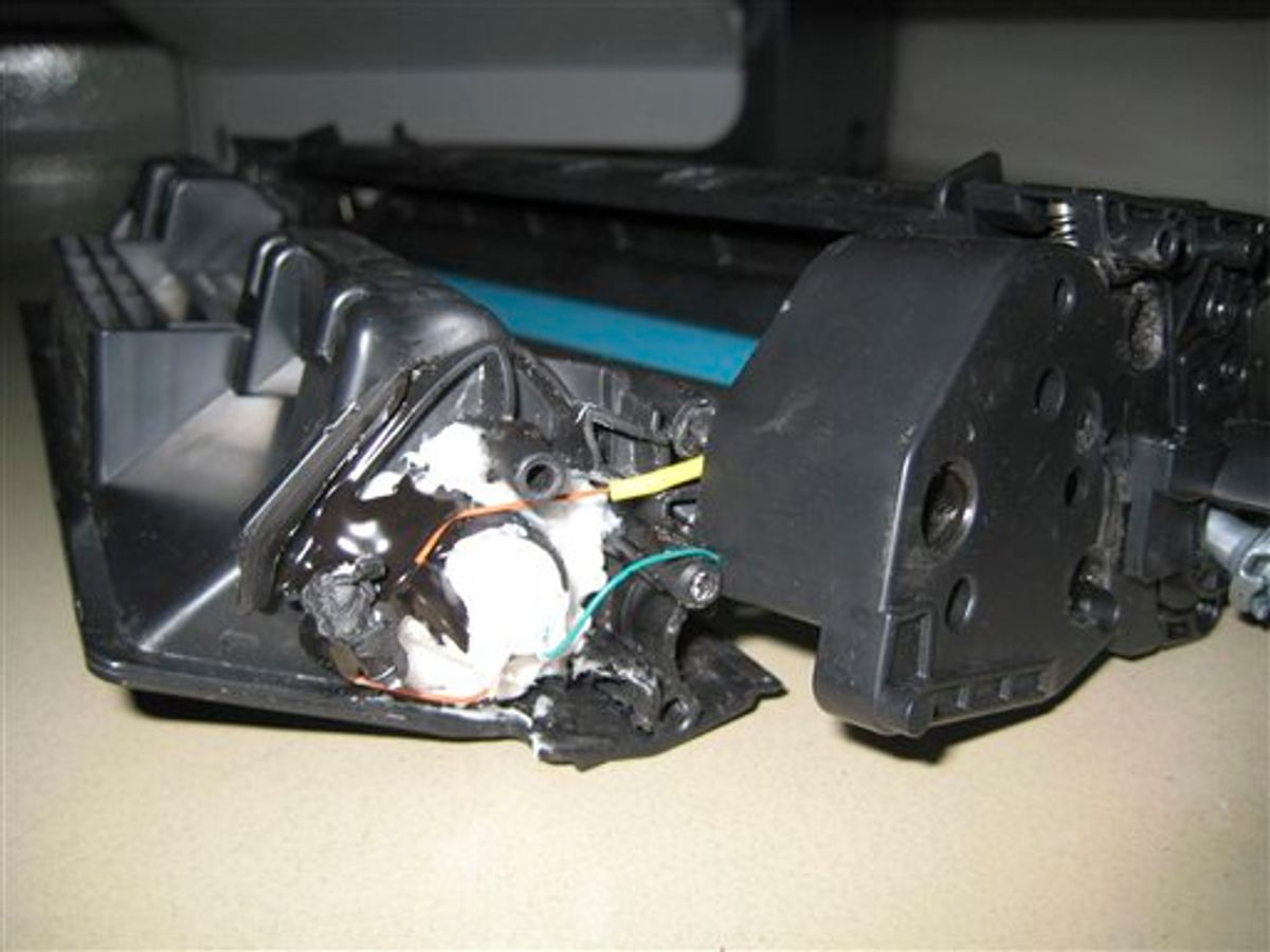This undated photo released by the Dubai Police via the state Emirates News Agency (WAM) on Saturday, Oct. 30, 2010, claims to show parts of a computer printer with explosives loaded into its toner cartridge found in a package onboard a cargo plane coming from Yemen, in Dubai, United Arab Emirates. Dubai police say the bomb, discovered in the ink cartridge of a computer printer in a shipment of air cargo from Yemen bound for the United States, contained the powerful explosive PETN and bore the hallmarks of al-Qaida. (AP Photo/Dubai Police via Emirates News Agency) EDITORIAL USE ONLY, NO SALES (AP)
