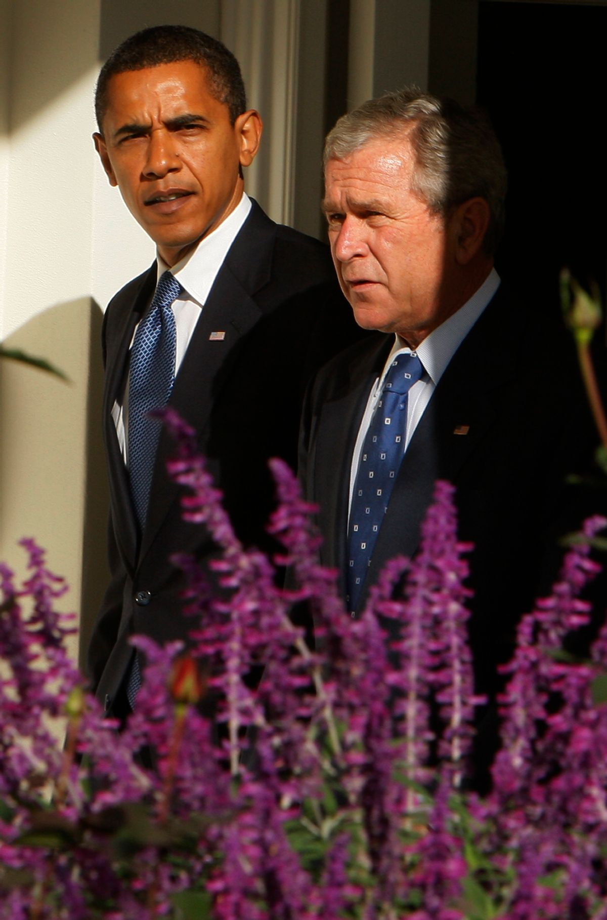 President Bush and President-elect Obama walk along the West Wing Colonnade of the White House in Washington, Monday, Nov. 10, 2008 prior to their meeting in the Oval Office. (AP Photo/Charles Dharapak) (Associated Press)