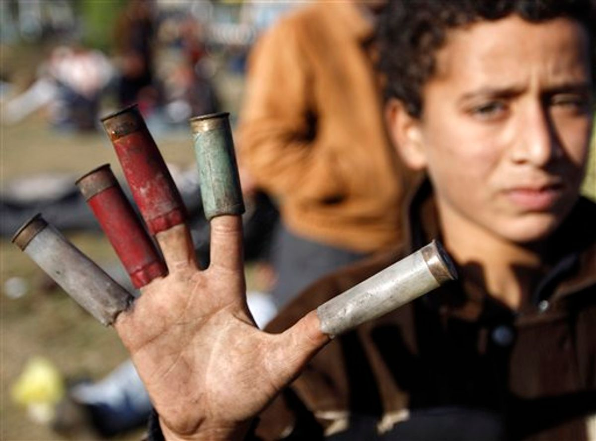 A boy shows spent cartridges used by Egyptian security forces, in Cairo, Sunday, Jan. 30, 2011. The Arab world's most populous nation appeared to be swiftly moving closer to a point at which it either dissolves into widespread chaos or the military expands its presence and control of the streets. (AP Photo/Tara Todra Whitehill) (AP)