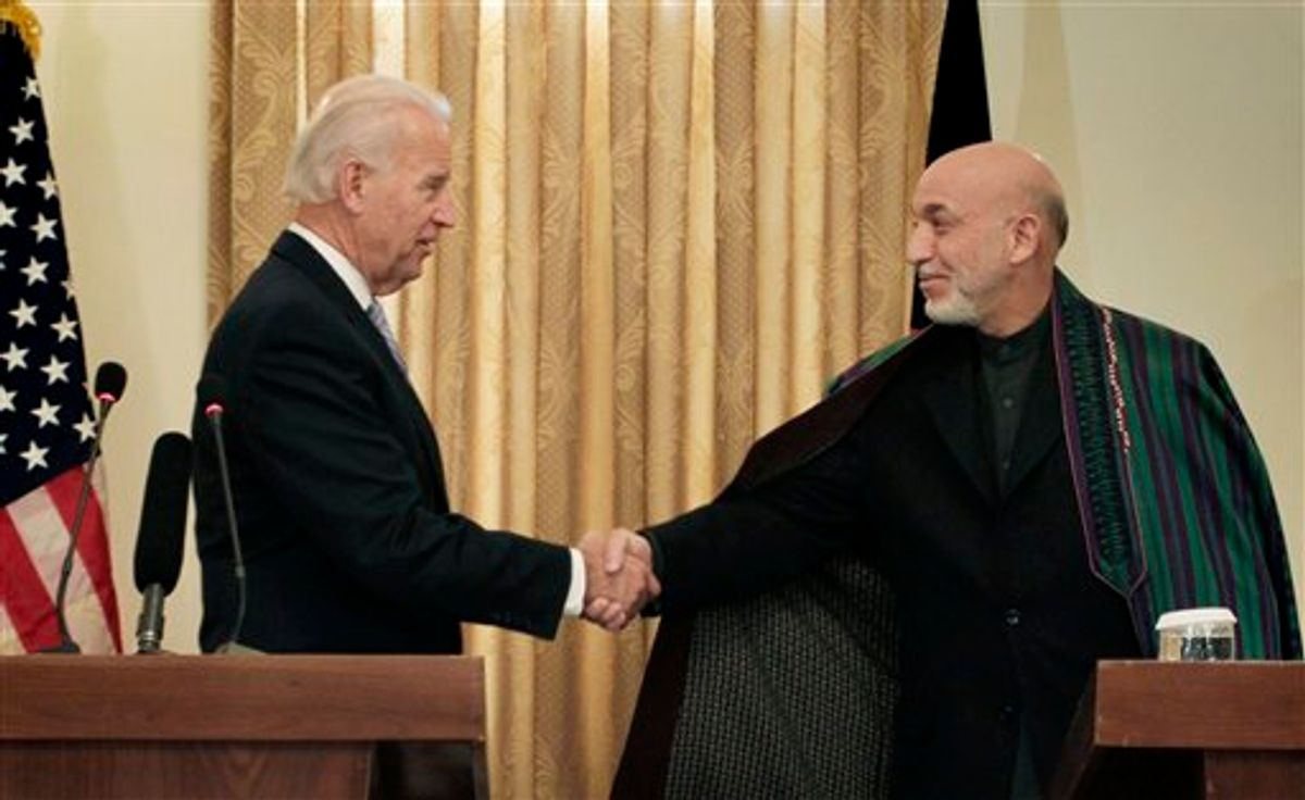 Afghan President Hamid Karzai, right, shakes hand with U.S. Vice President Joe Biden during a press conference in Kabul, Afghanistan, on Tuesday, Jan. 11, 2011. (AP Photo/Musadeq Sadeq)    (AP)