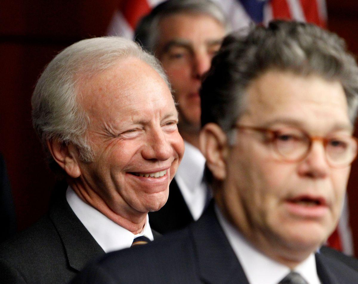 Sen. Joseph Lieberman, I-Conn., left, laughs as Sen. Al Franken, D-Minn., right, speaks during a news conference on Capitol Hill in Washington, Thursday, Nov. 18 ,2010, to push for the repeal of military Don't Ask Don't Tell rule. (AP Photo/Ann Heisenfelt) (AP)