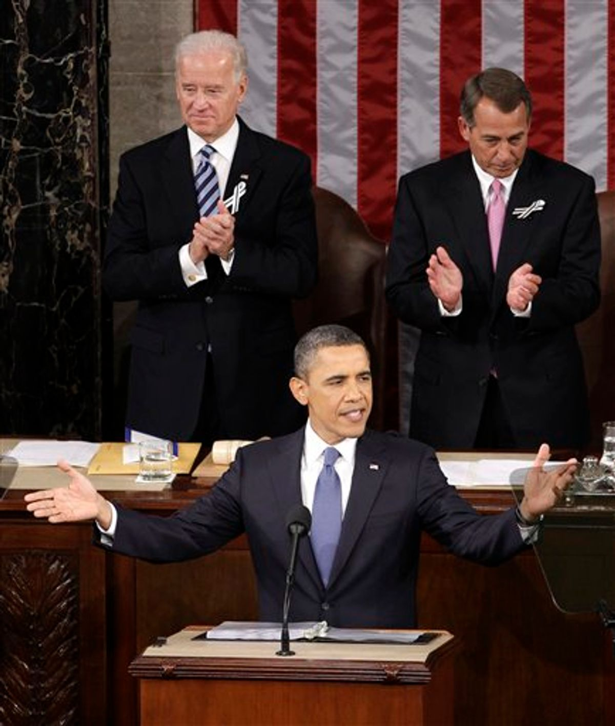 President Barack Obama gestures on Capitol Hill in Washington, Tuesday, Jan. 25, 2011, prior to delivering his State of the Union address in Washington, Tuesday, Jan. 25, 2011. Vice President Joe Biden and House Speaker John Boehner of Ohio applaud at rear. (AP Photo/Charles Dharapak) (AP)