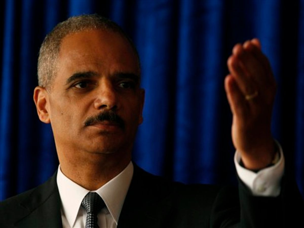 U.S. Attorney General Eric Holder gestures while speaking during a news conference in Hong Kong Tuesday, Oct. 19, 2010. The U.S. Attorney General on Tuesday urged Beijing to release Nobel Peace Prize winner Liu Xiaobo, a day before he was scheduled to meet with top law enforcement officials in mainland China. But Holder said he is unlikely to bring up Liu during his meetings in Beijing, which will focus on piracy and counterfeiting issues.  (AP Photo/Kin Cheung) (AP)
