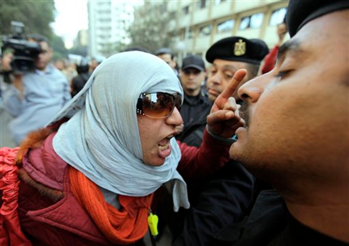 Angery Egyptian activist shouts at anti-riot policemen who block the way leading to journalists syndicate in downtown Cairo, Egypt, Wednesday, Jan. 26, 2011. A small gathering of Egyptian anti-government activists tried to stage a second day of protests in Cairo Wednesday in defiance of a ban on any gatherings, but police quickly moved in and used force to disperse the group. (AP Photo/Ben Curtis) (AP)
