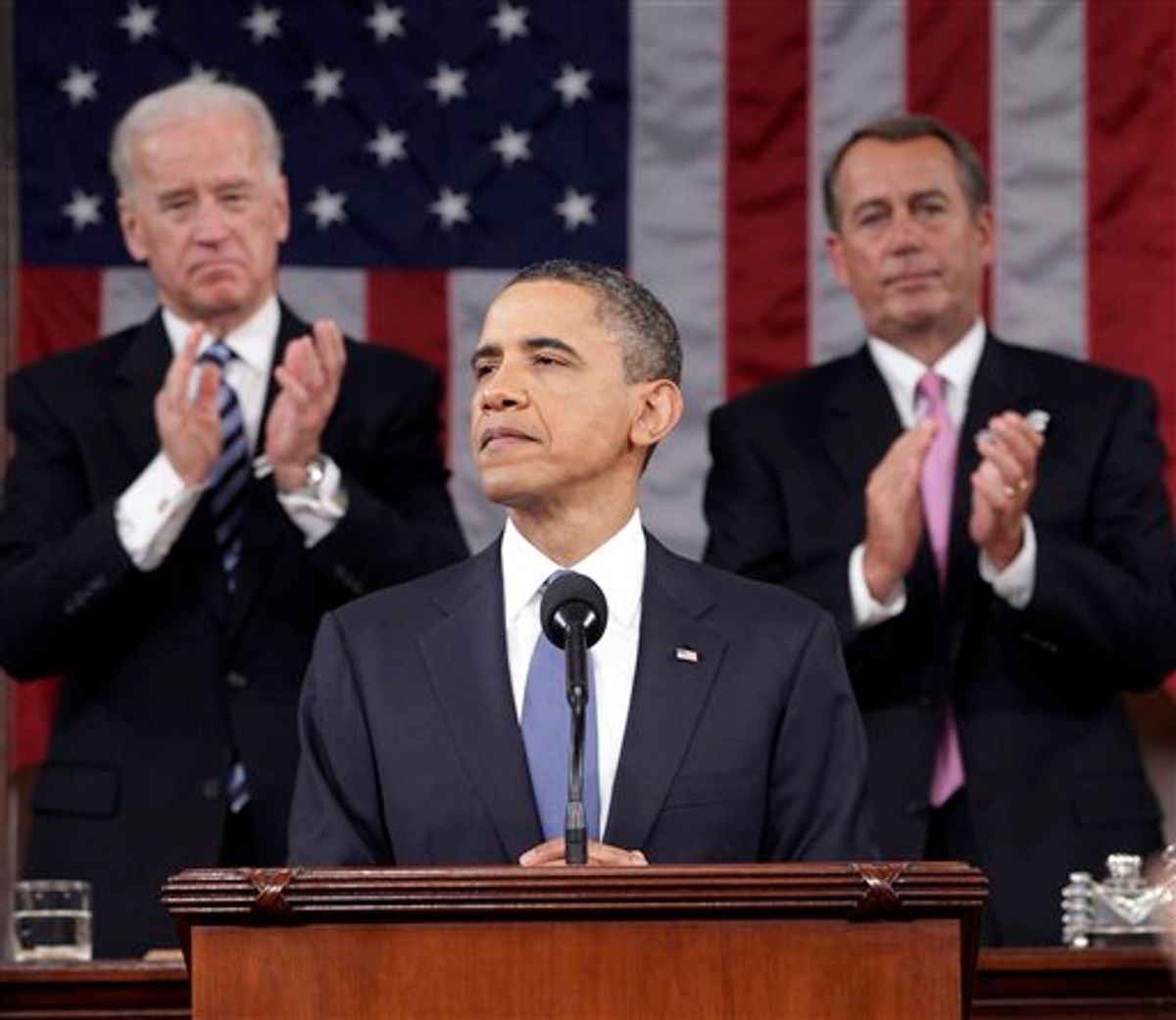 President Barack Obama is applauded by Vice President Joe Biden and House Speaker John Boehner on Capitol Hill in Washington, Tuesday, Jan. 25, 2011, while delivering his State of the Union address  (AP Photo/Pablo Martinez Monsivais, Pool) (AP)