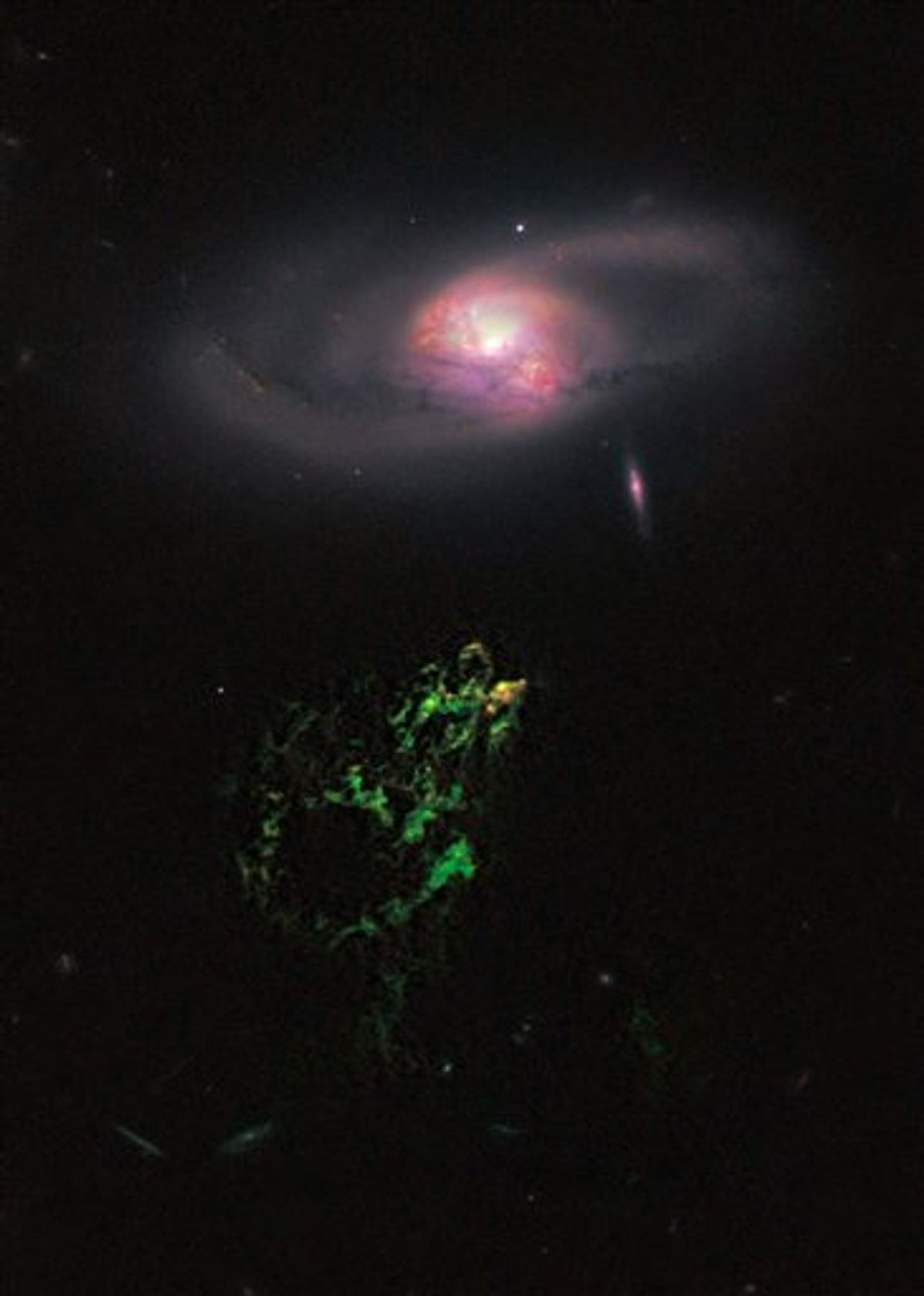 This handout photo provided by NASA, taken April 12, 2010 by the Hubble Space Telescope, shows an unusual, ghostly green blob of gas appears to float near a normal-looking spiral galaxy. NASA released Monday the Hubble Space Telescope's first picture of the mysterious giant glowing green blob of gas called Hanny's Voorwerp.  The blob is the size of our Milky Way galaxy and is 650 million light years away. Each light year is about 6 trillion miles. The blob was discovered in 2007 by Dutch school teacher Hanny van Arkel. (AP Photo/Hubble Space Telescope Science Institute)  (AP)