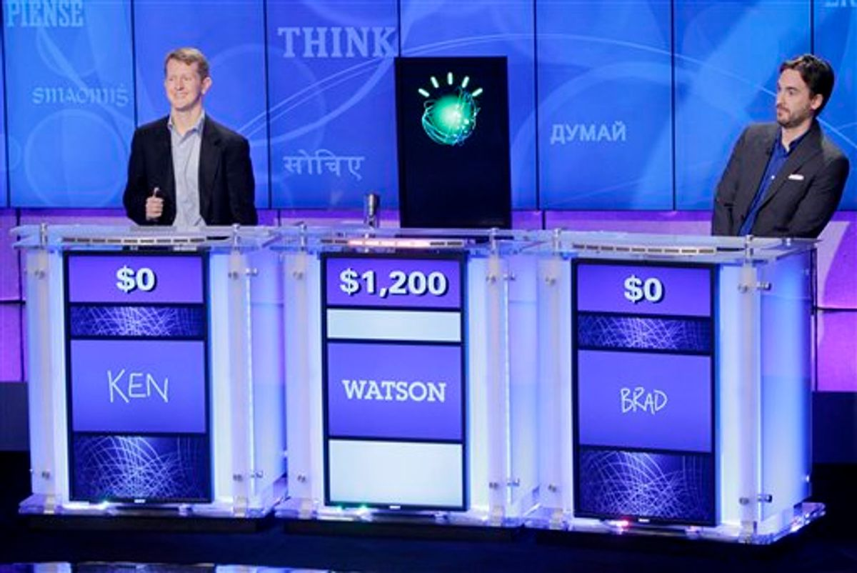 """""""Jeopardy!"""" champions Ken Jennings, left, and Brad Rutter, right, look on as an IBM computer called """"Watson"""" beats them to the buzzer to answer a question during a practice round of the """"Jeopardy!"""" quiz show in Yorktown Heights, N.Y., Thursday, Jan. 13, 2011. It's the size of 10 refrigerators, and it swallows encyclopedias whole, but an IBM computer was lacking one thing it needed to battle the greatest champions from the """"Jeopardy!"""" quiz TV show - it couldn't hit a buzzer. But that's been fixed, and on Thursday the hardware and software system named Watson played a competitive practice round against two champions. A """"Jeopardy!"""" show featuring the computer will air in mid-February, 2011. (AP Photo/Seth Wenig) (AP)"""