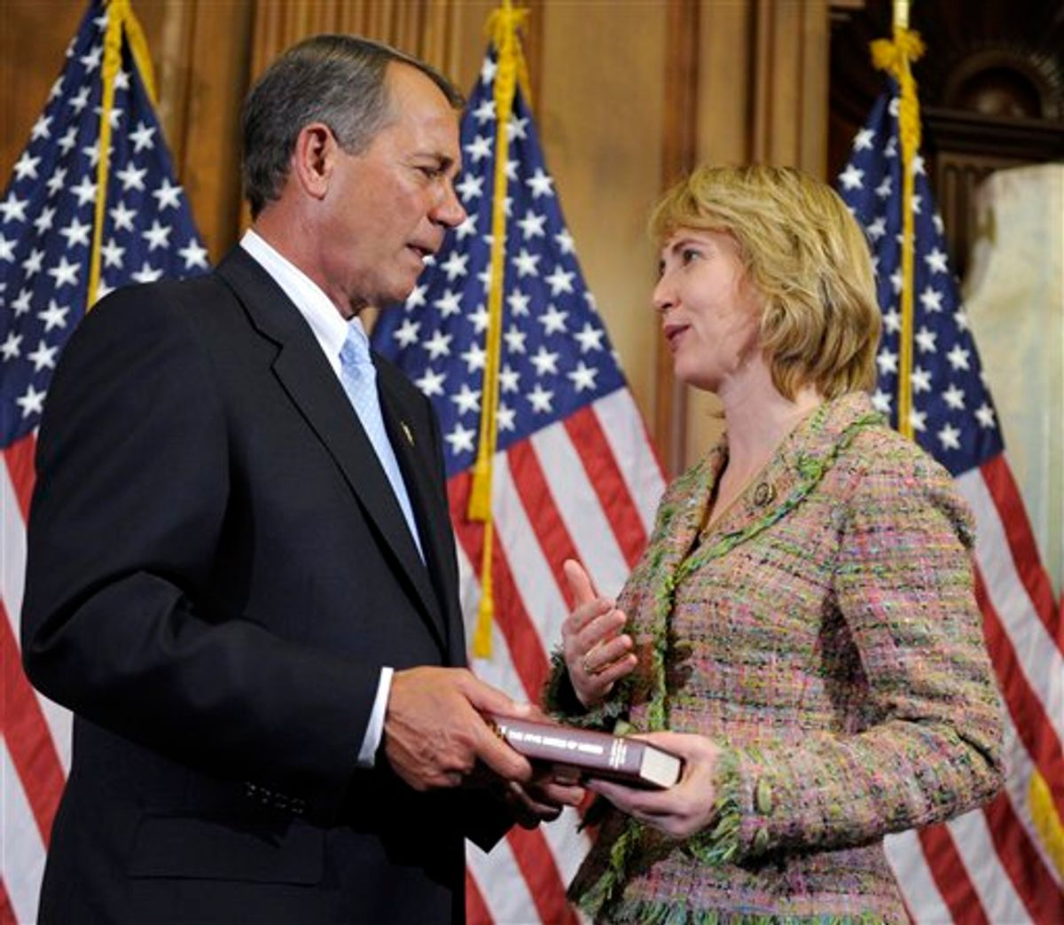 """FILE - In a Jan. 5, 2011 file photo, House Speaker John Boehner of Ohio reenacts the swearing in of Rep. Gabrielle Giffords, D-Ariz., on Capitol Hill in Washington. She loves motorcycles and yoga, and is as comfortable in a business suit walking the halls of Congress as she is clad in leather riding gear at the famed Sturgis Motorcycle Rally. She holds a master's degree in urban planning, yet can mount a tire in a flash. Pretty and petite, sometimes soft-spoken, she will take on even her most ardent   adversaries and try talking them down with a firm hand but also a smile. Said one friend of Gabrielle Giffords: """"She really pretty much defies a lot of description.""""  (AP Photo/Susan Walsh, File) (AP)"""