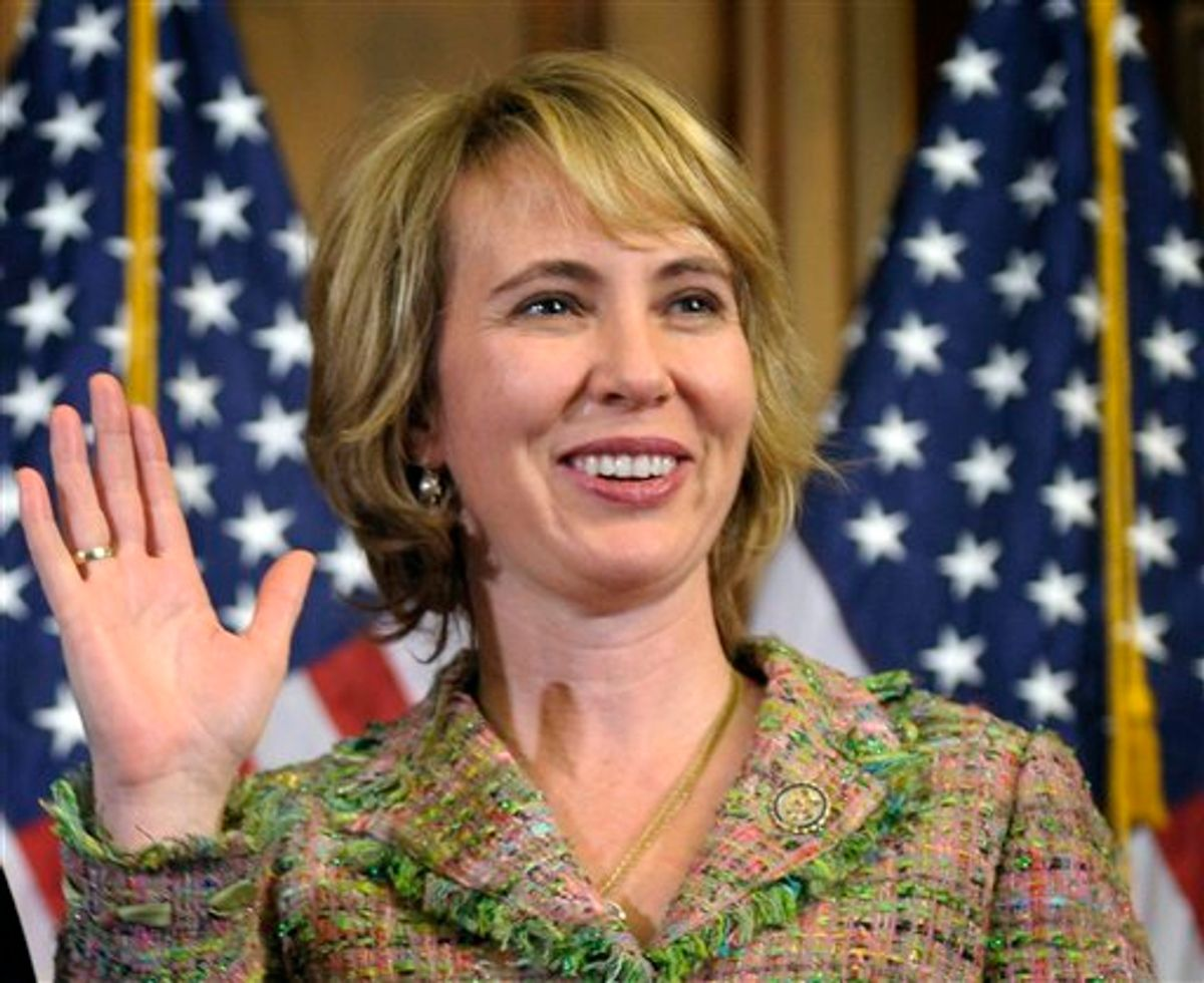 In this photo taken Wednesday, Jan. 5, 2011, Rep. Gabrielle Giffords, D-Ariz., takes part in a reenactment of her swearing-in, on Capitol Hill in Washington. Rep. Gabrielle Giffords of Arizona was shot in the head Saturday, Jan. 8, 2011 when an assailant opened fire outside a grocery store during a meeting with constituents, killing at least five people and wounding several others in a rampage that rattled the nation.  (AP Photo/Susan Walsh) (AP)