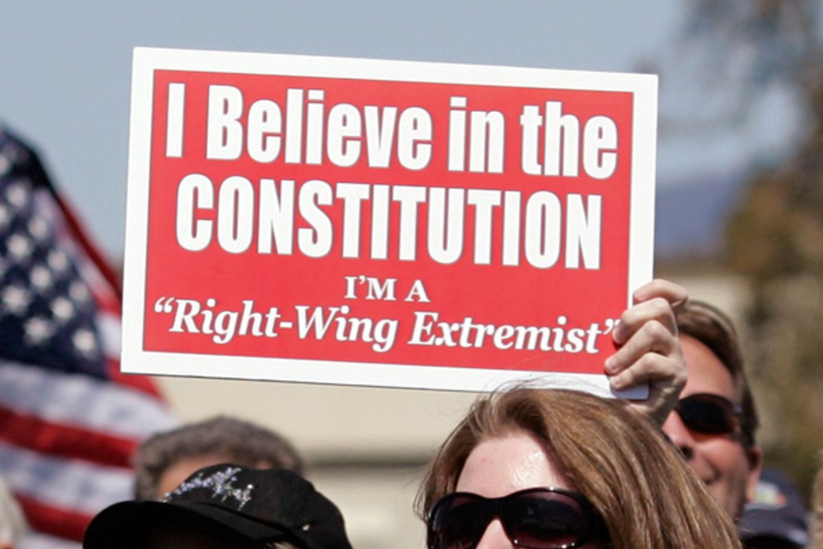 Detail of a sign signs during a Tax Day Tea Party demonstration in Pleasanton, Calif., Wednesday, April 15, 2009