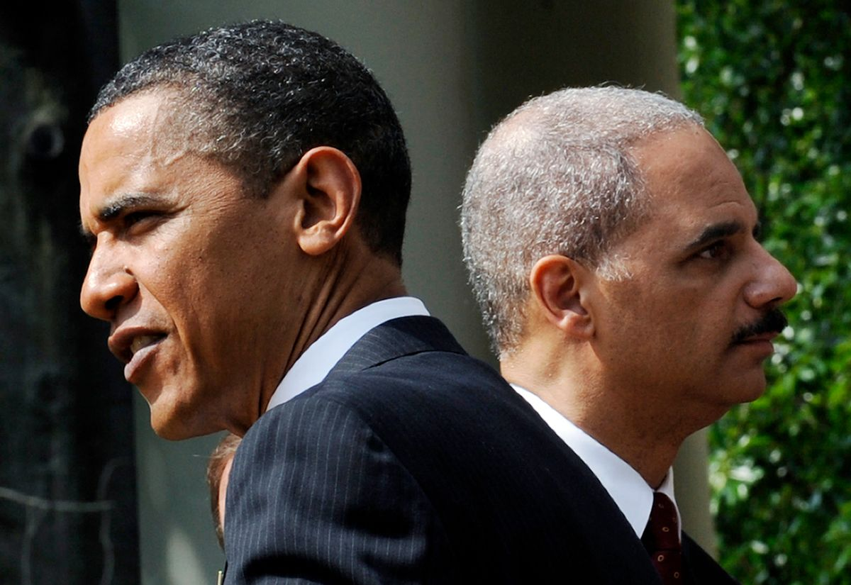 President Barack Obama and Attorney General Eric Holder in the Rose Garden of the White House in Washington while meeting with the 2010 National Association of Police Organizations award winners, Friday, May 14, 2010. (AP Photo/Susan Walsh)   (Associated Press)