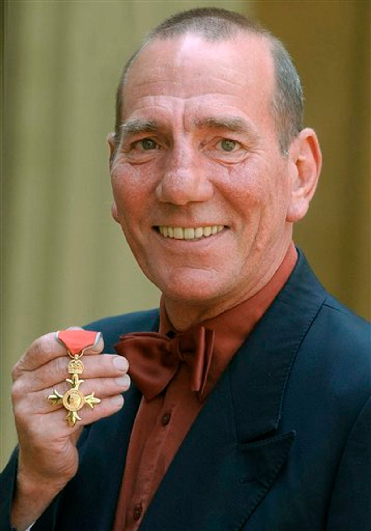 FILE -A Wednesday, June 9, 2004 photo from files showing  British actor Peter Postlethwaite displaying his Order of the British Empire or OBE, shortly after the presentation at Buckingham Palace in London.  Britain's Press Association is reporting Monday, Jan. 3, 2011 that decorated film actor Pete Postlethwaite has died at the age of 64. It quotes longtime friend Andrew Richardson as saying Monday that Postlethwaite died in hospital in Shropshire, central England, after a long illness. Richardson said Postlethwaite died Sunday. He had been receiving treatment for cancer.  (AP Photo /Kirsty Wigglesworth/ Pool) (AP)