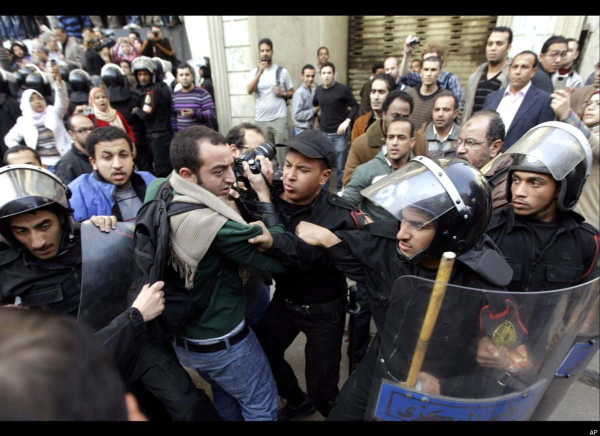 Protesters clash with riot police in Cairo.