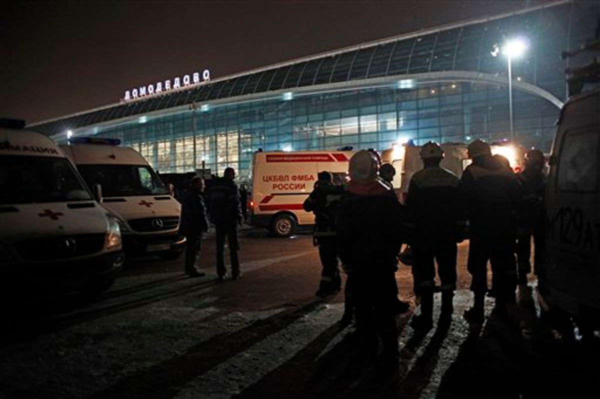 Ambulance vehicles and emergency workers are seen in front of Domodedovo airport in Moscow, Monday, Jan. 24, 2011. An explosion ripped through the international arrivals hall at Moscow's busiest airport on Monday, killing dozens of people and wounding scores, officials said. The Russian president called it a terror attack. (AP Photo/Alexander Zemlianichenko) (AP)