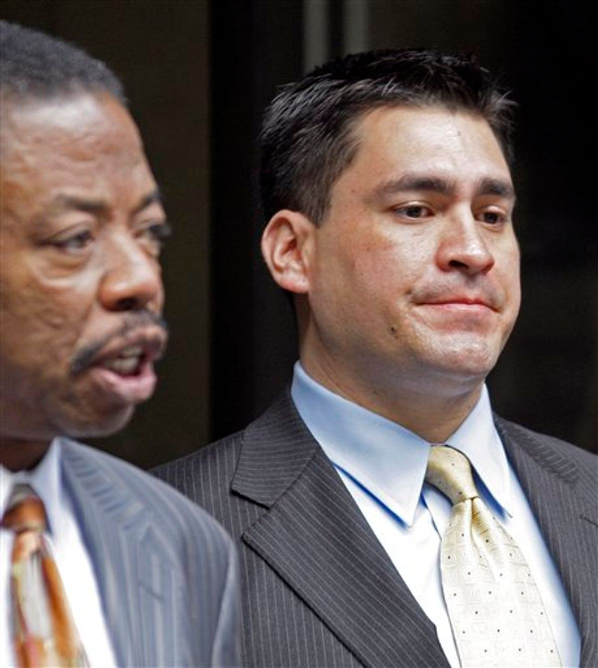 Security guard Alberto Alvarez, right, listens as his attorney Carl Douglas talks to reporters as they leave the preliminary hearing for Michael Jackson's doctor Conrad Murray who is charged in the death of the singer, at Los Angeles Superior Court, Wednesday, Jan. 5, 2011.  (AP Photo/Reed Saxon) (AP)