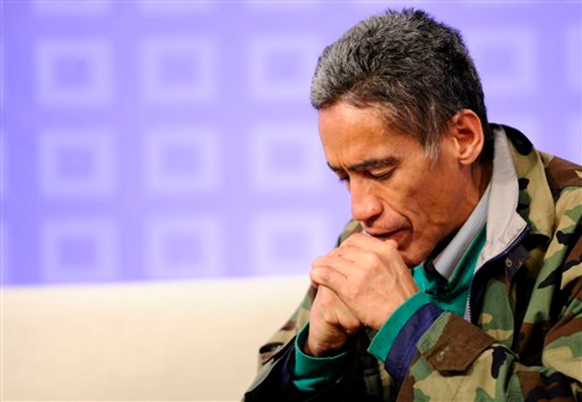 """In this photo provided by NBC Universal, homeless man Ted Williams prays during NBC's """"Today"""" show, in New York, on Thursday, Jan. 6, 2011. Williams, who was living in a tent near a highway in Columbus, Ohio, just days ago, was in New York for an emotional reunion with his 90-year-old mother, media appearances, and to do some commercial voiceover work. On the """"Today"""" show, he described his previous 48 hours as """"outrageous."""" (AP Photo/NBC, Peter Kramer) NO SALES (AP)"""
