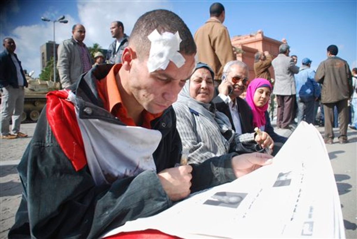 A wounded man reads a newspaper in Cairo, Egypt, Monday Jan. 31, 201. A coalition of opposition groups called for a million people to take to Cairo's streets Tuesday to ratchet up pressure for President Hosni Mubarak to leave.  (AP Photo/Mohammed Abou Zaid) (AP)