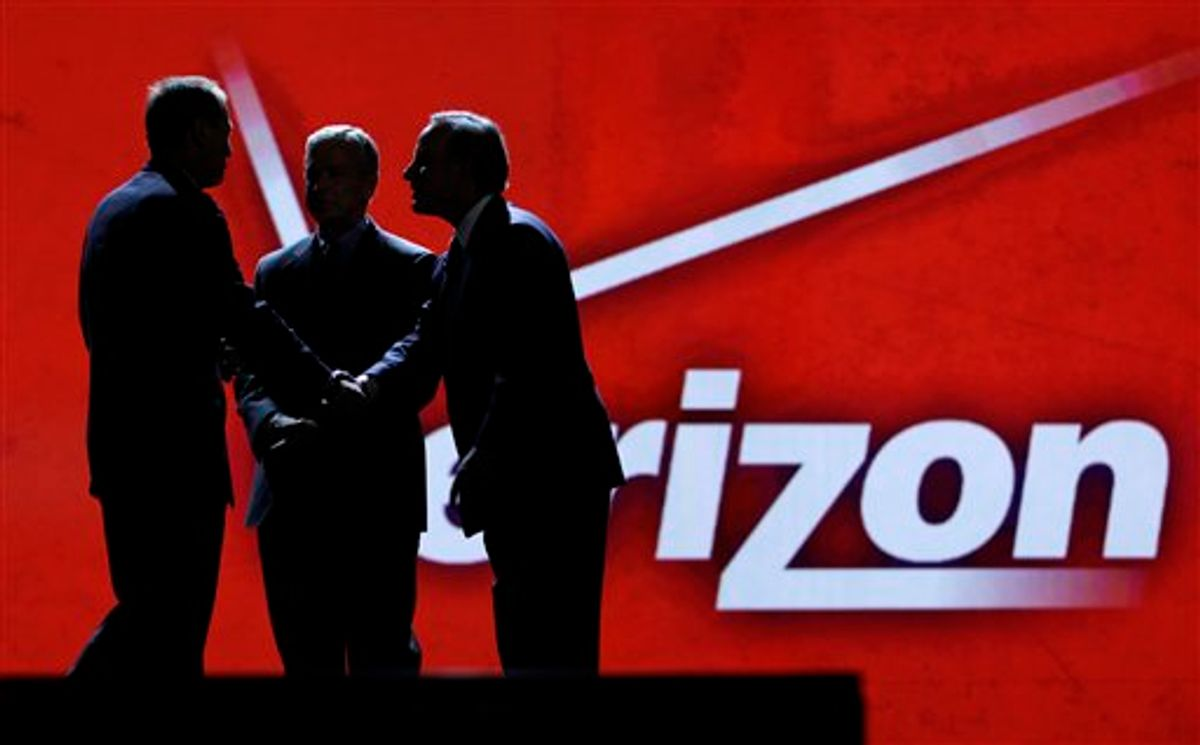 FILE - In this file photo taken Jan. 6, 2011,Consumer Electronics Association president and Chief Executive Officer Gary Shapiro, left, greets Verizon Communications Inc., chairman and Chief Executive Officer Ivan Seidenberg, right, and president and Chief Operating Officer Lowell McAdam during the Consumer Electronics Show, in Las Vegas. As the tech industry awaits a likely Verizon iPhone announcement on Tuesday, Jan. 11, 2011,shares of Apple Inc. hit a record high during Monday trading.  (AP Photo/Julie Jacobson, file) (AP)