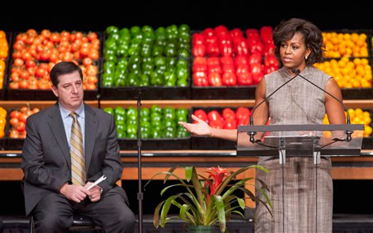 Wal-Mart President and CEO Bill Simon looks on as First lady Michelle Obama takes part in Wal-Mart's announcement of a comprehensive effort to provide healthier and more affordable food choices to their customers, Thursday, Jan. 20, 2011, in Washington. (AP Photo/Cliff Owen) (AP)