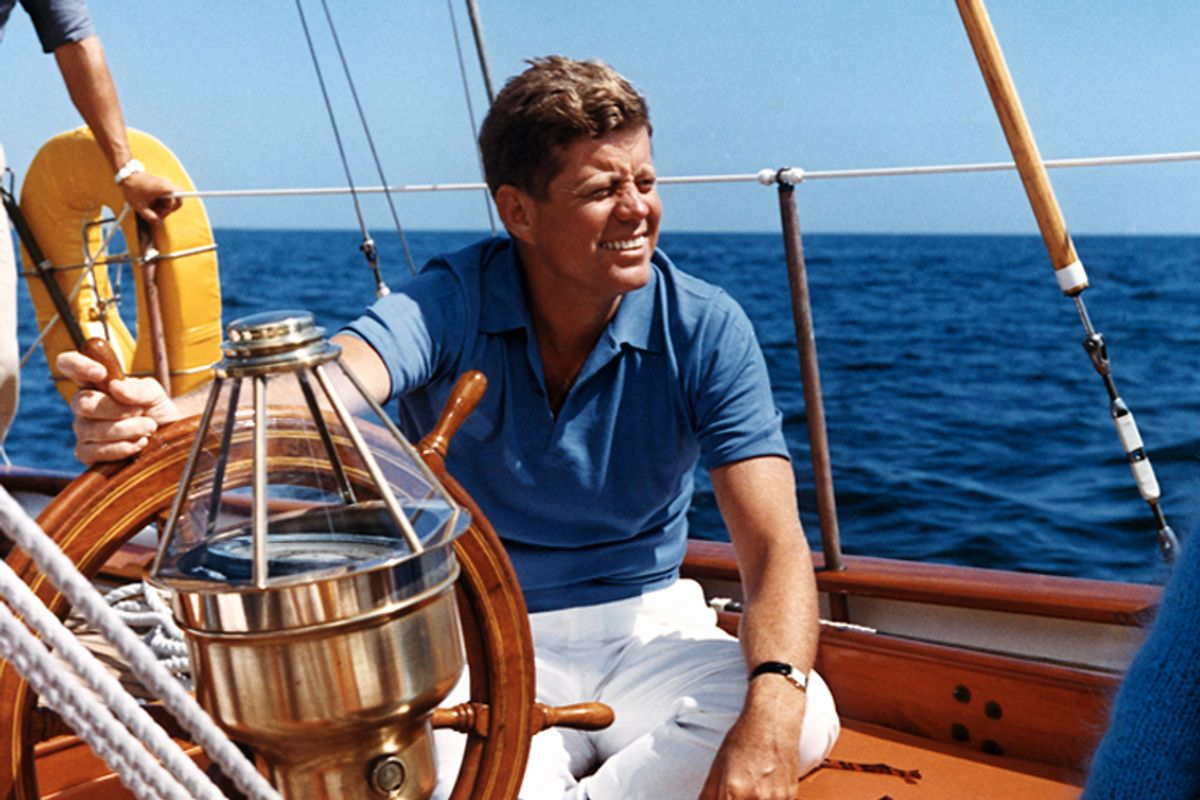 """President Kennedy sailing aboard the U.S. Coast Guard yacht """"Manitou"""" in August 1962."""