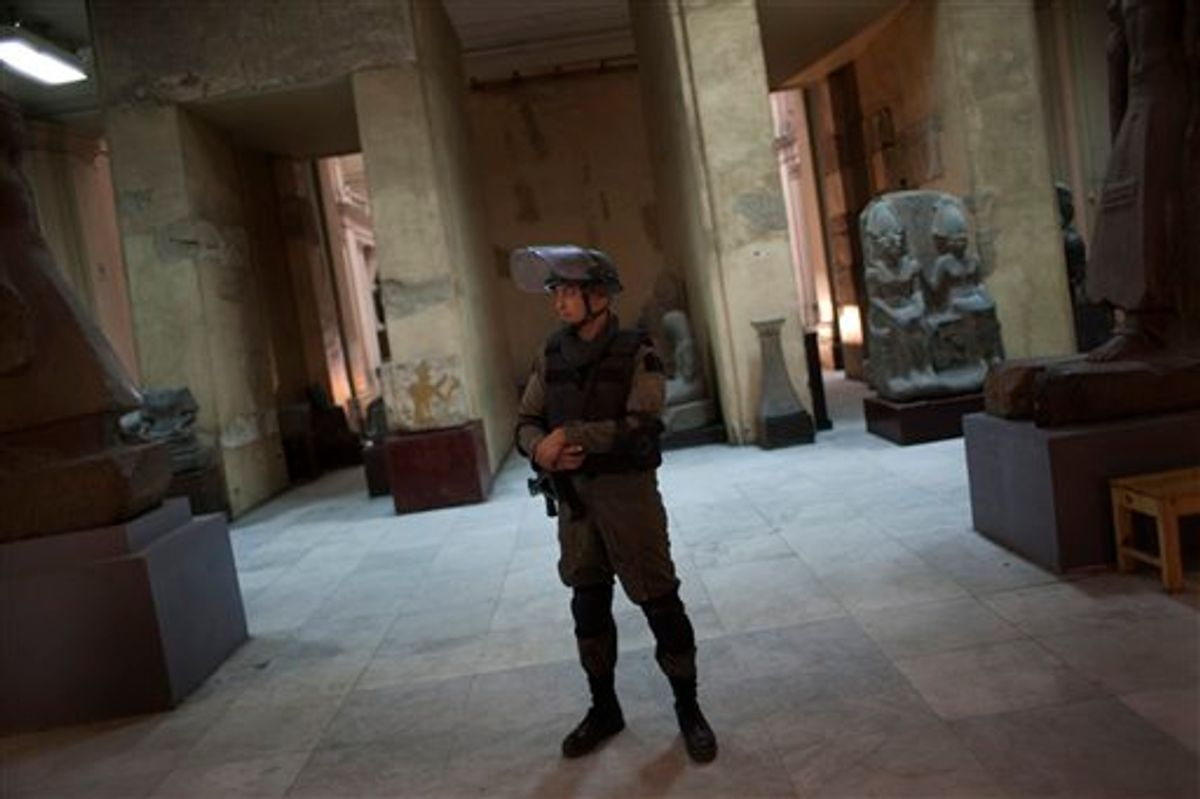 A member of the Egyptian special forces stands guard on the main floor of the Egyptian Museum in Cairo, Egypt, Thursday, Feb. 10, 2011. Would-be looters broke into Cairo's famed Egyptian Museum on Saturday, Jan. 29, ripping the heads off two mummies and damaging about 75 small artifacts before being caught and detained by army soldiers. (AP Photo/Emilio Morenatti) (AP)