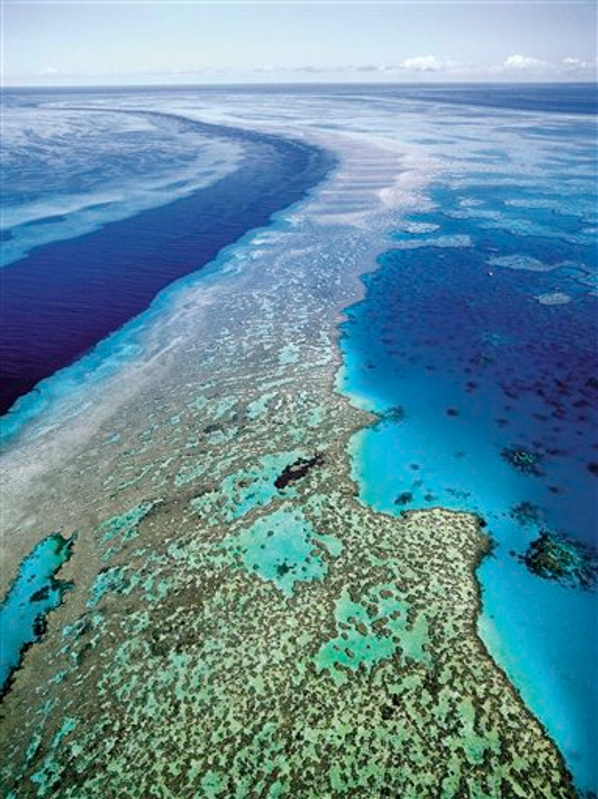 FILE - In this Sept. 2001 file photo provided by Queensland Tourism, the Great Barrier Reef off Australia's Queensland state is shown in an aerial view. Researchers said it is too early to know exactly how much of the reef has been affected by recent flooding, which carved a wide path of destruction on land before draining into the sea off the country's northeast coast. (AP Photo/Queensland Tourism, File)  EDITORIAL USE ONLY  (AP)