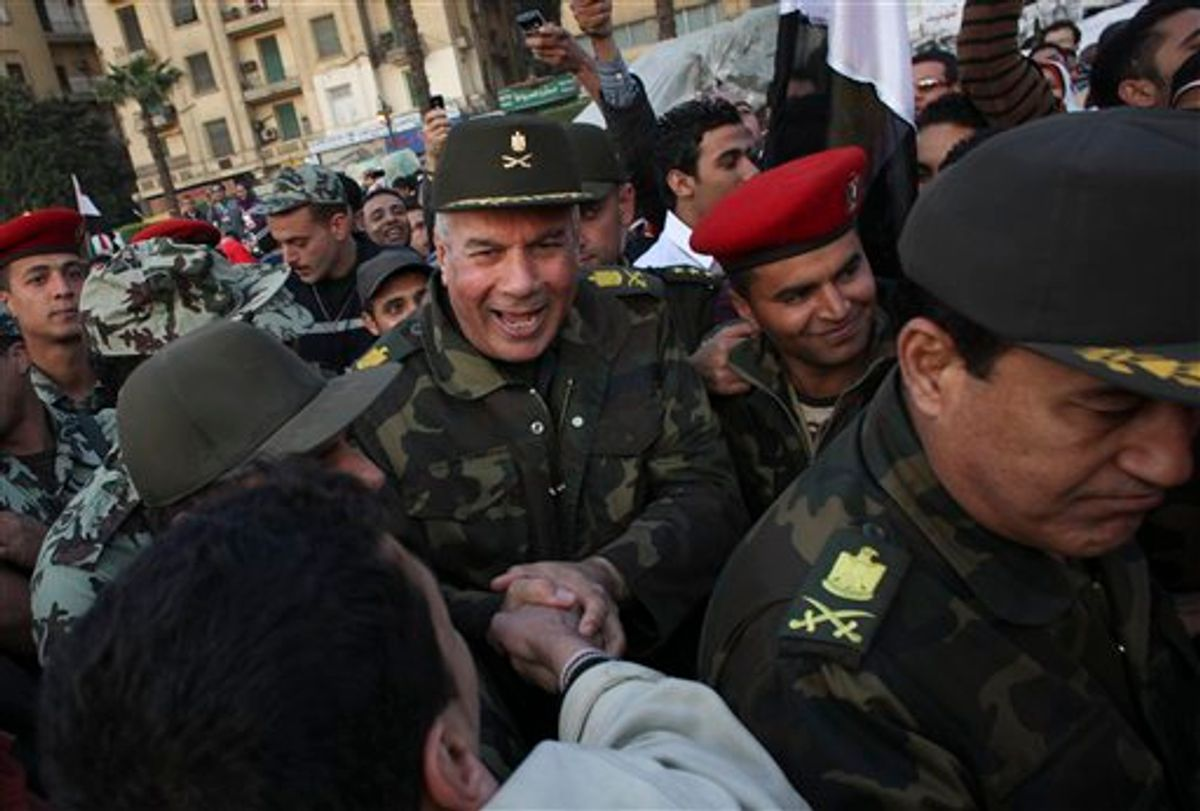 Unidentified  Egyptian army major generals greet people as they walk through Tahrir Square in Cairo, Egypt, Saturday, Feb. 12, 2011. Egypt exploded with joy, tears, and relief after pro-democracy protesters brought down President Hosni Mubarak on Friday with a momentous march on his palaces and state TV. The ruling military pledged Saturday to eventually hand power to an elected civilian government and reassured allies that Egypt will abide by its peace treaty with Israel. (AP Photo/Tara Todras-Whitehill) (AP)