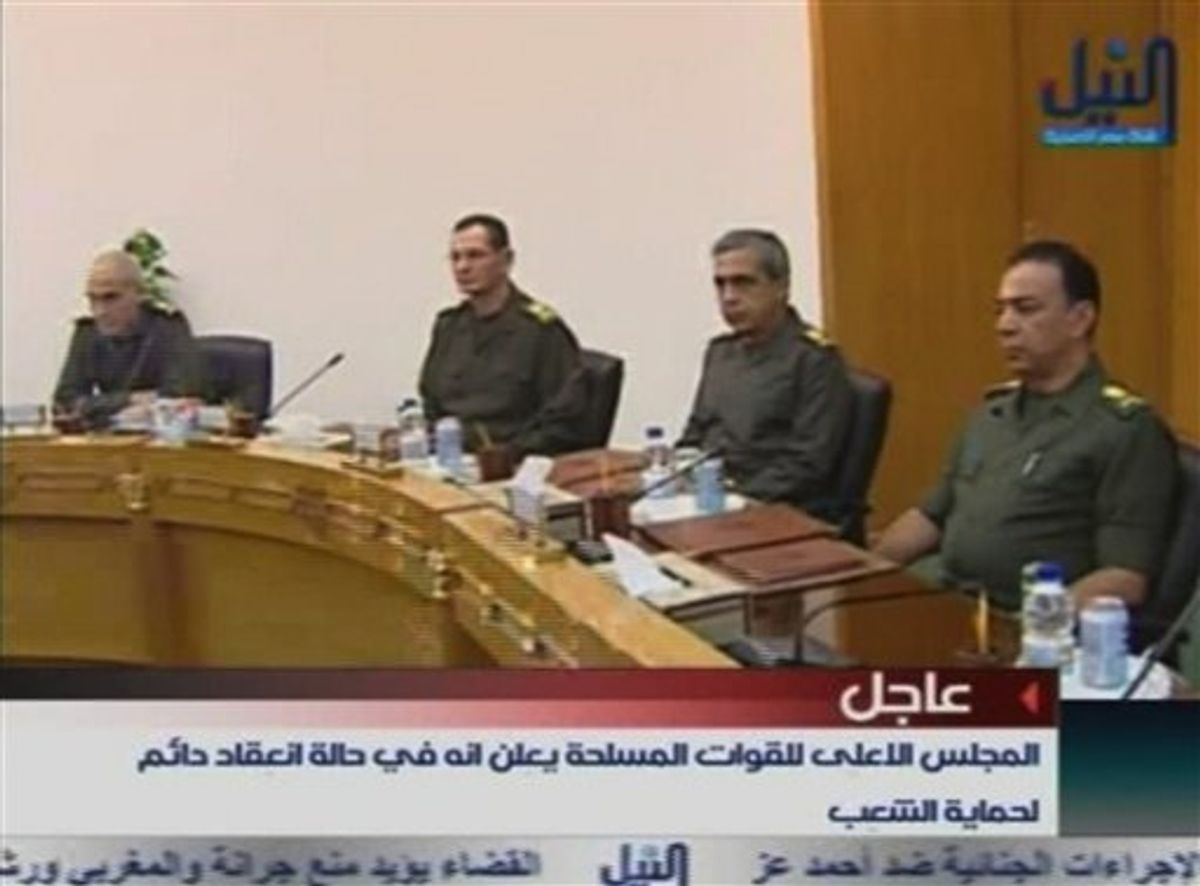 """Members of Egypt's military supreme council attend a meeting  in this image taken from TV Thursday Feb. 10, 2011. President Hosni Mubarak will meet the demands of protesters, military and ruling party officials said Thursday in the strongest indication yet that Egypt's longtime president may be about to give up power and that the armed forces were seizing control. The military's supreme council was meeting Thursday, without the commander in chief Mubarak, and announced on state TV its """"support of the legitimate demands of the people."""" (AP Photo/Nile TV via APTN)  EGYPT OUT TV OUT  (AP)"""
