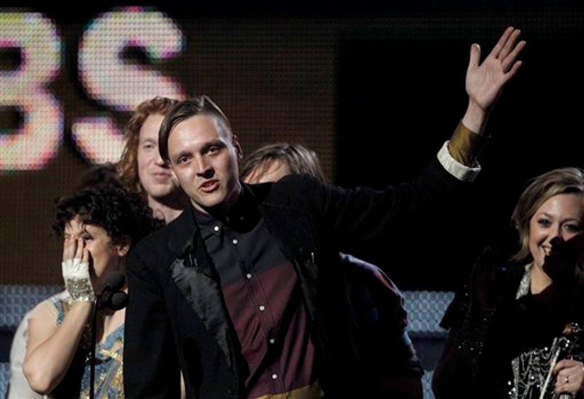 Win Butler, center, is joined by fellow band members of Arcade Fire to accept the award for album of the year at the 53rd annual Grammy Awards on Sunday, Feb. 13, 2011, in Los Angeles. (AP Photo/Matt Sayles)    (AP)
