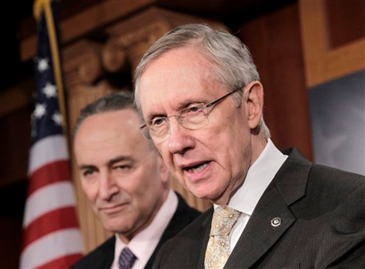 Senate Majority Leader Harry Reid of Nev., accompanied by Sen. Charles Schumer, D-N.Y., speaks during a news conference on Capitol Hill in Washington, Tuesday, Feb. 2, 2011, to respond to Republican critics on health care and the aviation bill. (AP Photo/J. Scott Applewhite)      (AP)