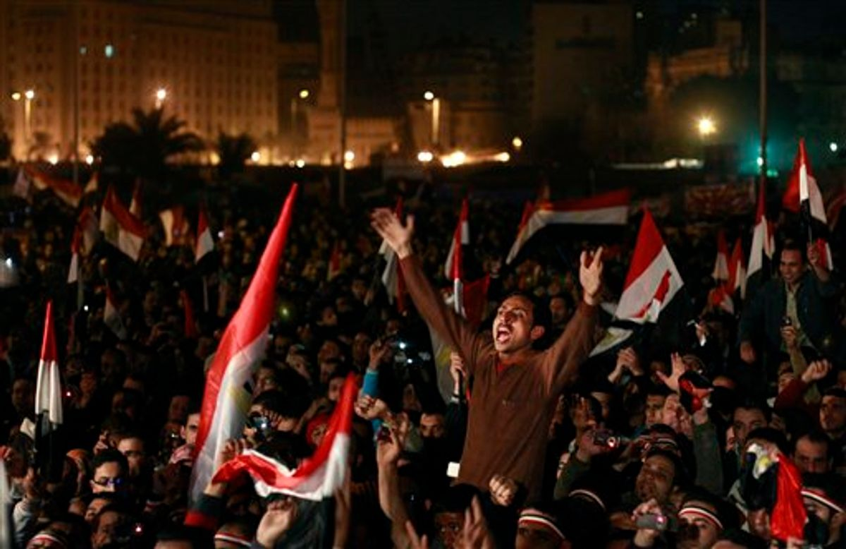 Egyptians celebrate the news of the resignation of President Hosni Mubarak, who handed control of the country to the military, at night in Tahrir Square in downtown Cairo, Egypt Friday, Feb. 11, 2011. (AP Photo/Ben Curtis) (AP)